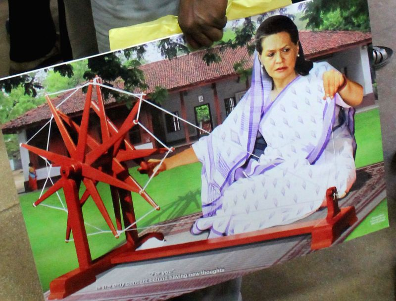 A painting which depicts Congress president Sonia Gandhi running a charkha in Hyderabad on May 5, 2014. The painting is going to be put up in a wall of Telangana Congress office.