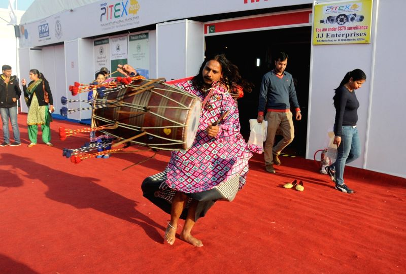 A Pakistani dholi - percussionist - performs during the Punjab International Trade Expo 2015 (PITEX 2015) in Amritsar on Dec 3, 2015.