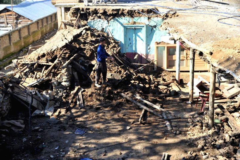 A Pakistani earthquake survivor stands at his collapsed house in earthquake-hit northwest Pakistan's Lower Dir, Oct. 28, 2015. The international community ...