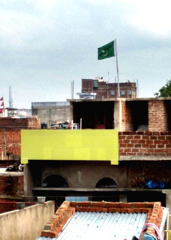A Pakistani flag was hoisted atop a house owned by Anwarul Haq in Nalanda district of Bihar on July 21, 2016.