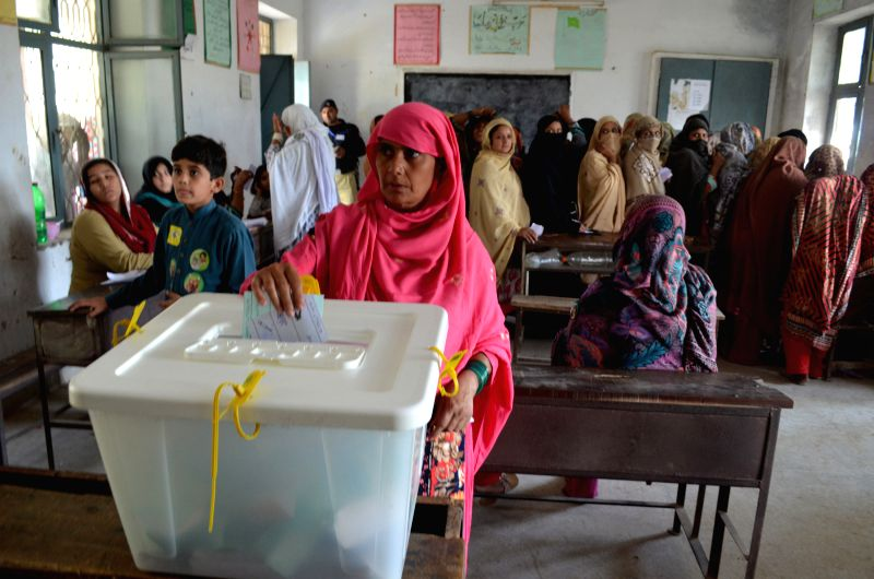 A Pakistani woman casts her ballot at a polling station during the local government elections in eastern Pakistan's Lahore, on Oct. 31, 2015. The first phase of the ...