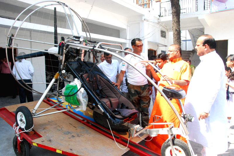 A paramotor trike is seen at state Congress headquarter in Dehradun on April 12, 2014. Congress party will deploy these vehicles for campaigning in the Lok Sabha election.