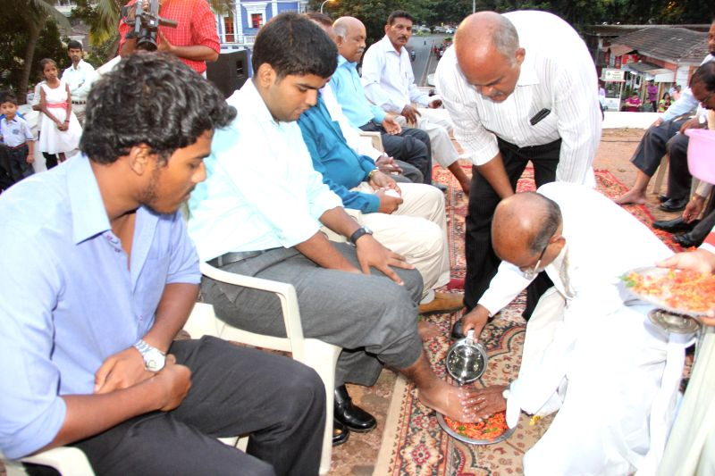 A parish priest of Our Lady of Immaculate Conception Church Fr. Cleto Pereira washing the feet of devotees on the occasion of Maundy Thursday also known as Holy Thursday in Panaji on April 17, 2014.