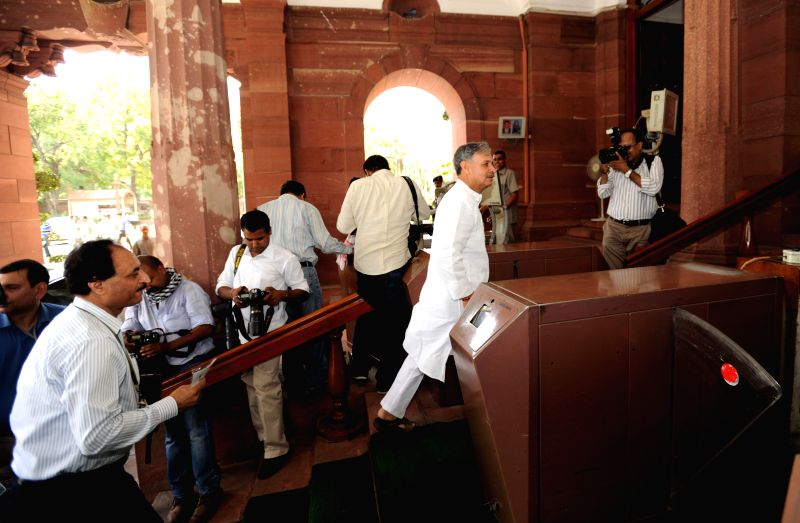 A Parliamentarian arrives at the Parliament to attend Budget Session 2014-15 in New Delhi on July 10, 2014.