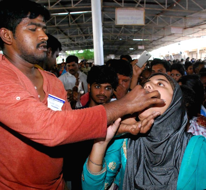 A patient receives Bathini Mrugasira Fish at Exhibition Grounds, Nampally in Hyderabad on June 8, 2017. A yellow herbal paste is stuffed inside the fishes and are pushed down the throat of ...