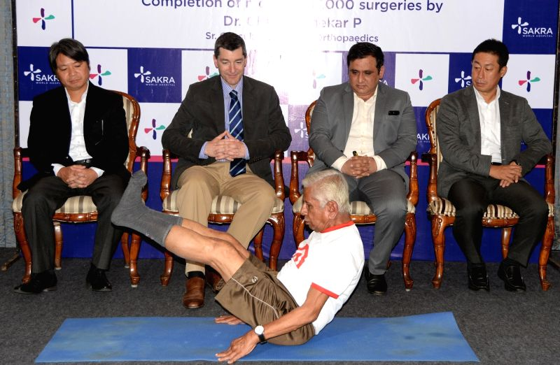 A patient who underwent knee replacement surgeries using the navigational technique performs yoga in front of Consultant and HOD – Orthopedics at Sakra World Hospital Dr. Chandrashekar P ...