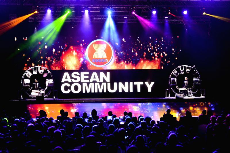 A performance is staged after the signing ceremony of member states of the Association of Southeast Asian Nations (ASEAN) in Kuala Lumpur, Malaysia, Nov. 22, ...