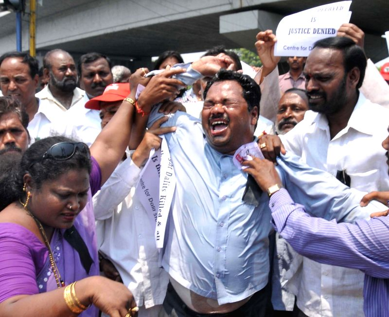 A person demanding justice for the 12 peopled who were killed in Chundur massacre tries self-immolation in Guntur district of Andhra Pradesh on April 23, 2014.