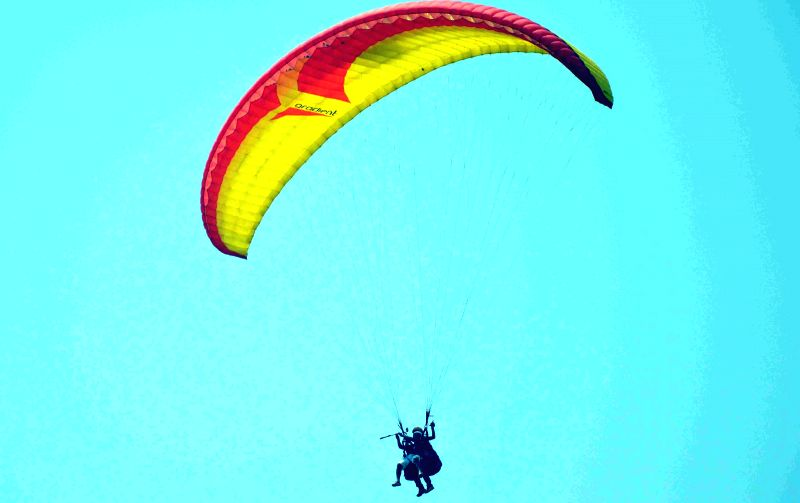 A person para-glides during the four day long 2nd Baokhungri Festival organised by Bodoland Territorial Council (BTC) Tourism Department at Baokhungri Hill, 10 km away from Kokrajhar on April 11, ...