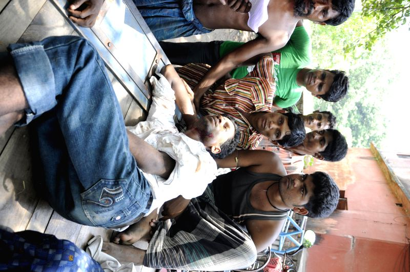 A person who got injured during a political clash in South 24 Parganas district of West Bengal being taken to a hospital for treatment on May 12, 2014.