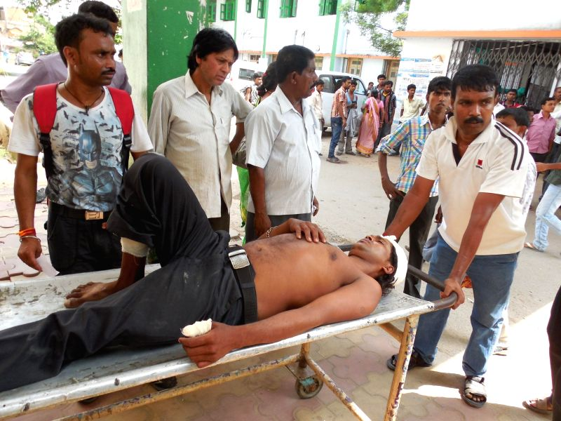 A person who suffered bullet injuries during a clash being wheeled in a hospital in Haroa of North 24 Parganas district  in West Bengal on May 12, 2014.