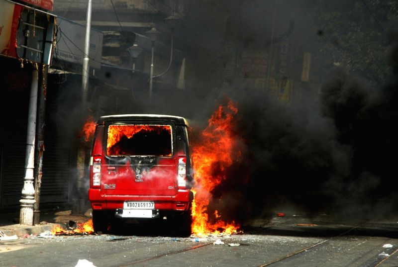 A police jeep torched by BJP workers during a protest in Kolkata on May 25, 2017.