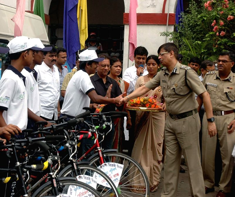 A police official meets the participants of an anti-drug cycle rally at Kolkata Police Headquarters in Kolkata on June 20, 2014.