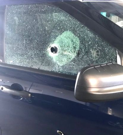 A police vehicle has bullet holes from shots fired on Sunday by the suspect in the killing of Telengana student Sharath Kopu in Kansas City. (Photo Source: Kansas City Police)