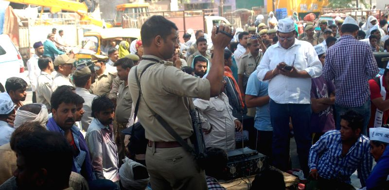 A policeman checks baggage of passengers at Nampally Railway station in light of the two bomb blasts that took place in the coaches of a Guwahati-Bangalore train, minutes after it chugged into the ...