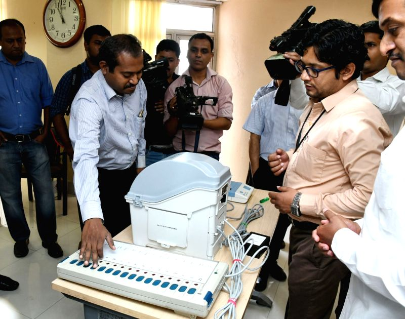 A political party delegation conducts a 'Mock Poll' on EVM machine, in New Delhi on June 3, 2017.