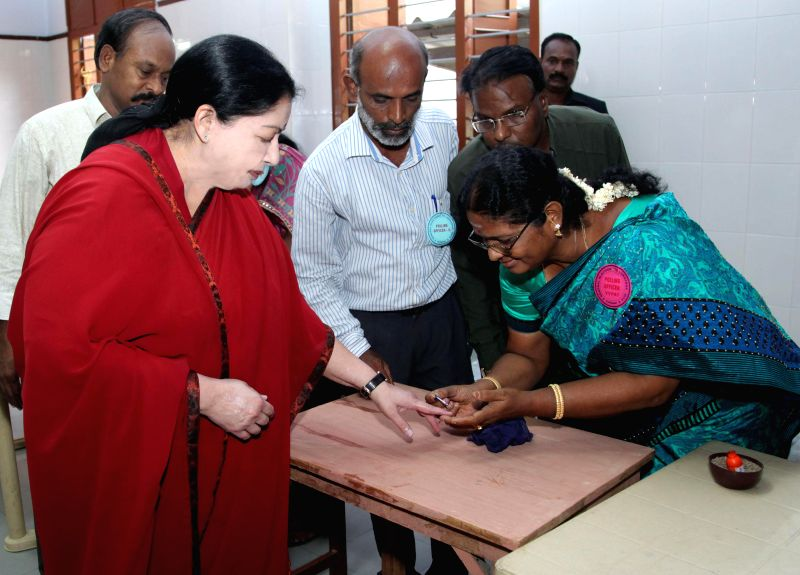 A polling personnel marks the forefinger of Tamil Nadu Chief Minister J Jayalalithaa with phosphorous ink  at a polling booth during the sixth phase of 2014 Lok Sabha Polls in Chennai on April 24, ...