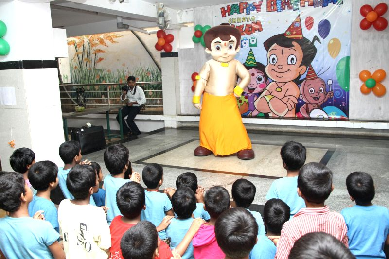 A popular cartoon icon Chota Bheem celebrates its 9th birthday with the destitute children at BOSCO Mane in Chamarajpet of Bangalore on  May 8, 2014.