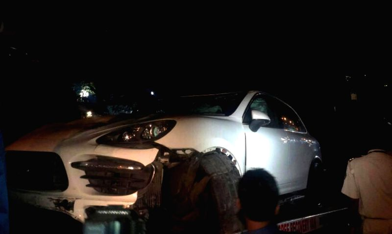 A Porsche car that met with an accident near actor Amitabh Bachchan's Juhu residence in Mumbai on July 1, 2014. The number plates of the car were missing when the press reached the spot.