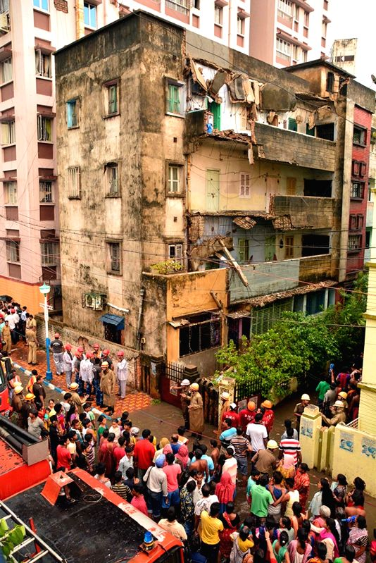 A portion of a building that collapsed during heavy rains in Kolkata on May 23, 2016.