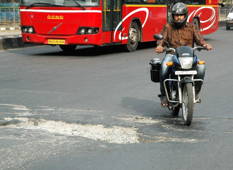 A pothole on Seshadri Road near the Maharani College Junction which is causing inconvenience to the drivers in Bangalore on April 27, 2014.