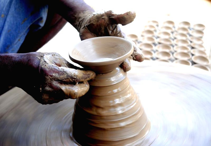 A potter busy making earthen lamps ahead of Diwali in Allahabad, on Oct 4, 2017.