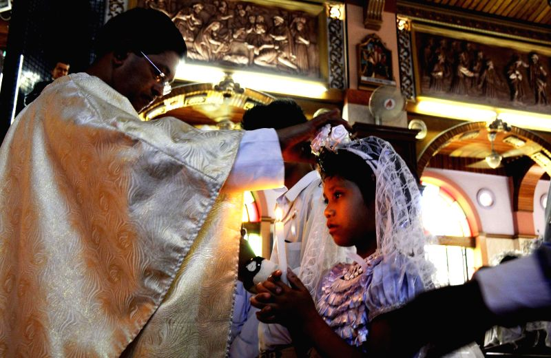 A priest addresses people on Easter Sunday at St. Basilica Church in Shivaji Nagar, of Bangalore on April 20, 2014.