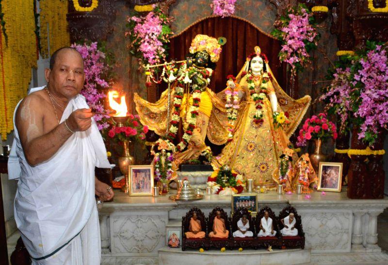 A priest worships lord Krishna and Radha at ISKCON Temple on Janmashtami in Guwahati on Aug 18, 2014.