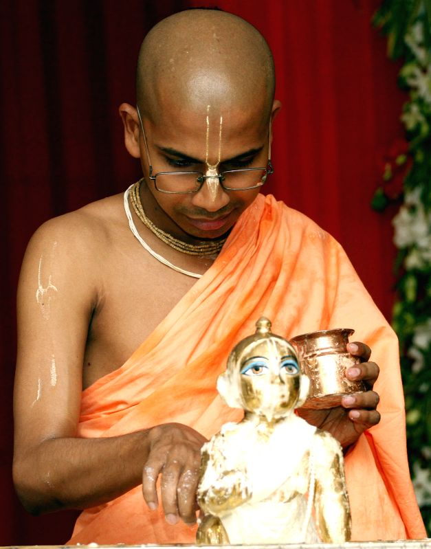 A priest worships lord Krishna on Janmashtami at ISKCON Temple in New Delhi on Aug 18, 2014.