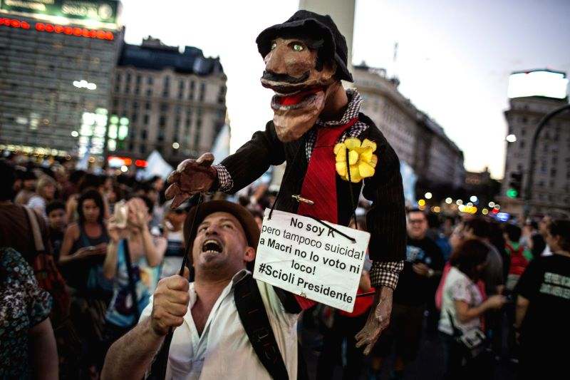 A puppeteer takes part in a rally in support of the presidential candidate of the ruling party Front for the Victory Daniel Scioli, in Buenos Aires city, ...