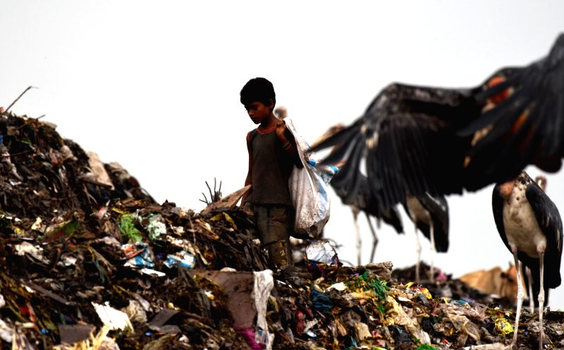 A rag-picker at work at a dumping Guwahati ground on June 4, 2017.