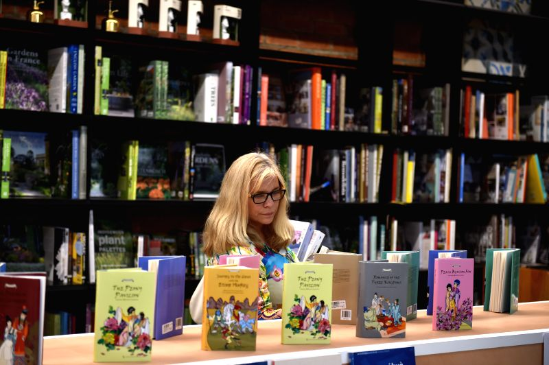 A reader chooses books at the Chinese Books section in a bookstore in Johannesburg, South Africa, Dec. 3, 2015. The one-week 2015 South African Exhibition on ...