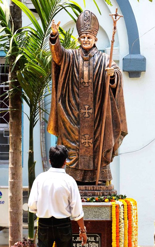 A recently installed statue of Pope John Paul II in Kolkata on April 27, 2014.