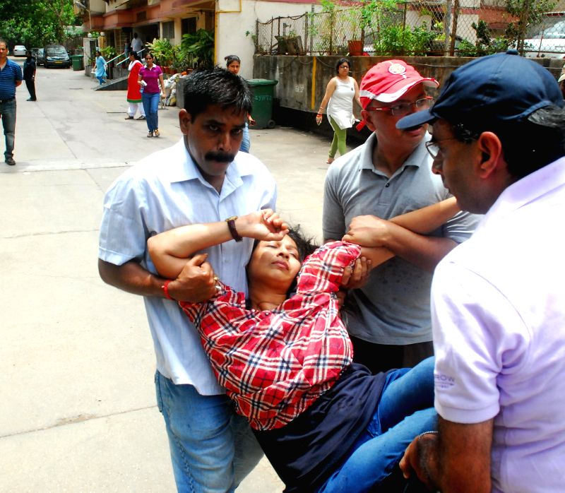 A resident of Worli's Campa Cola Compound who fell ill as the residents continued their struggle to prevent BMC personnel who had arrived to disconnect water, electricity and piped gas to the ...