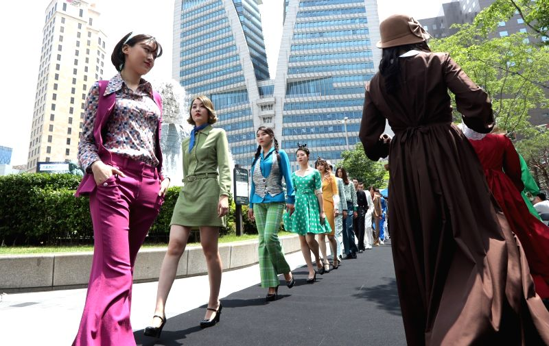 A retro style fashion show is under way at a fountain near the Bank of Korea in downtown Seoul on May 24, 2017.