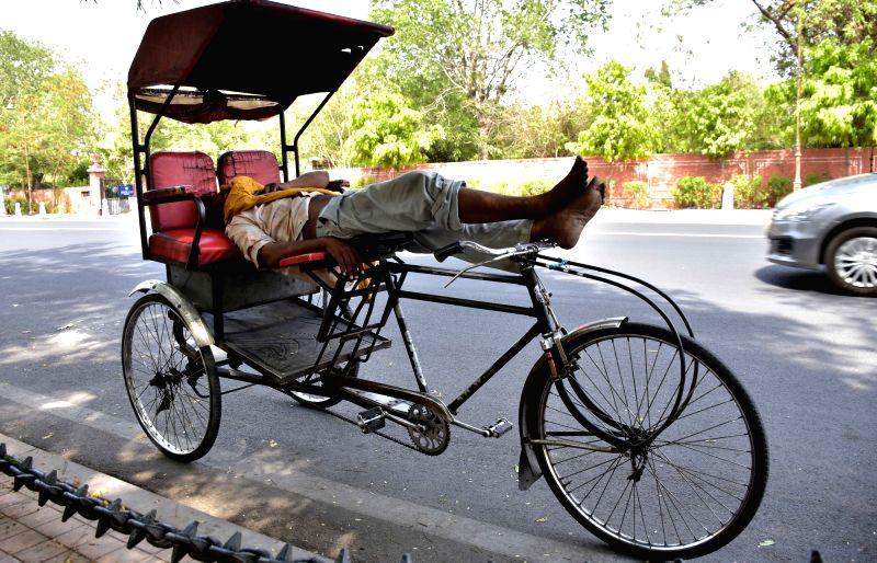 A rickshaw-puller enjoys his siesta in Jaipur, on May 27, 2017.