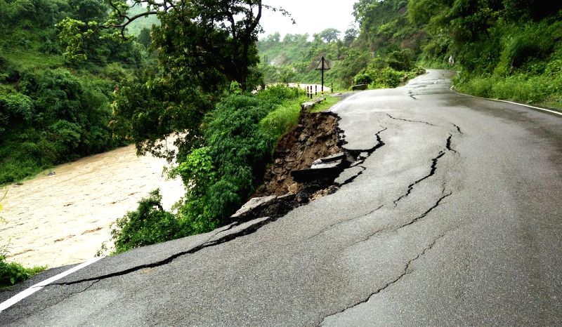 A road being damaged after a landslide due to heavy rains in Kotdwar district of Uttarakhand on July 22, 2016.