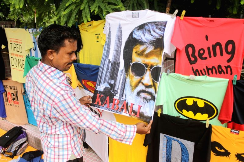 A roadside vendor displays a Kabali t-shirt ahead of film Kabali's release in Chennai on July 20, 2016.