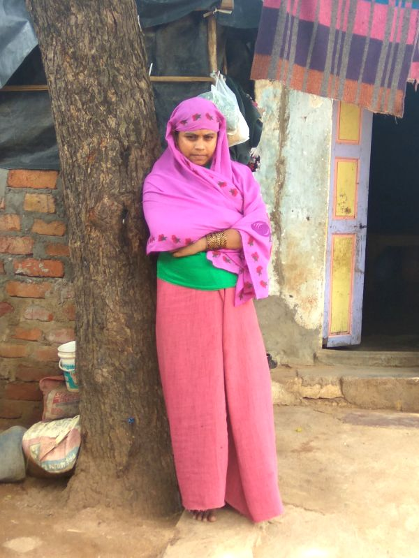A Rohangiya woman infront of her rented house in Hyderabad