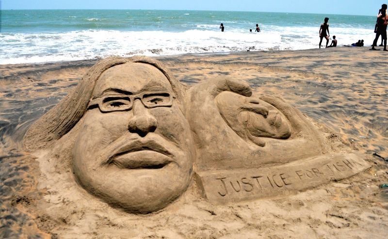 A sand sculpture condemning Kerala Dalit woman's murder on Payyambalam Beach in Kannur on May 9, 2016.