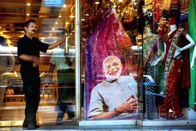 A saree with a picture of BJP Prime Ministerial candidate and Gujarat Chief Minister Narendra Modi printed on it displayed at a showroom in Mumbai on May 12, 2014.