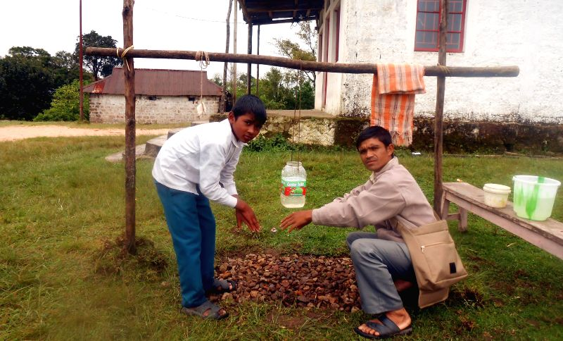 A Sarva Shiksha Abhiyan (SSA) staff gives a demonstration on hand-washing to students as a part of Intensified Diarrhoea Control Fortnight (IDCF) - 2014 campaign in Shillong on Aug 13, 2014.