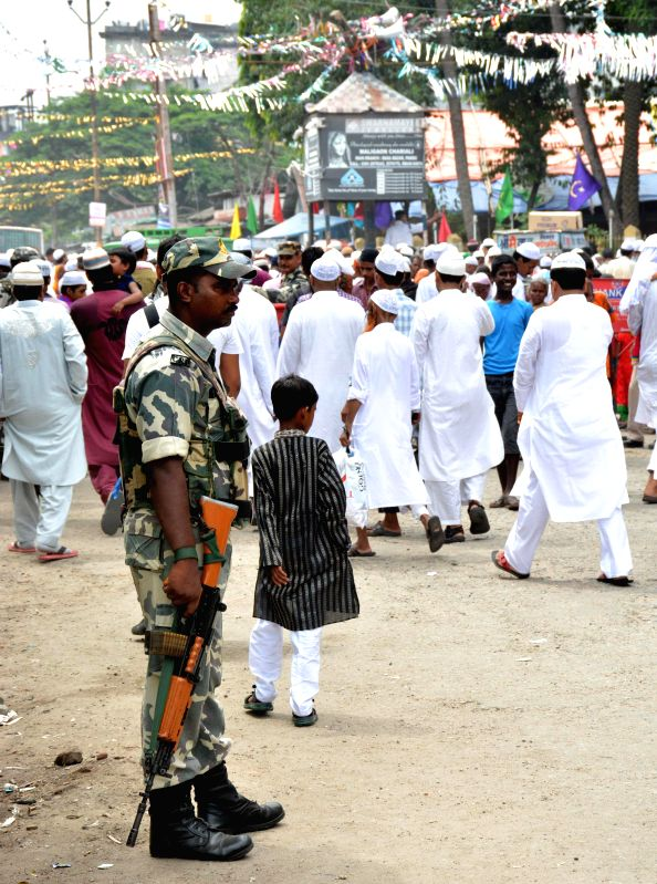 A security personnel keeps vigil during namaz on the occasion of Eid ul-Fitr celebrations at Iddgah field in Guwahati on Tuesday 29th July 2014.