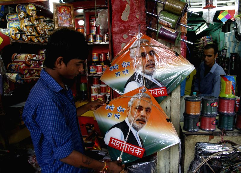 A shopkeeper sells a kite with an image of Prime Minister Narendra Modi ahead of Independence Day in New Delhi on Aug 11, 2014. - Narendra Modi