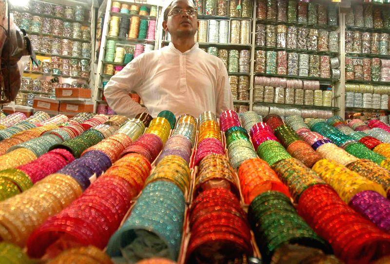 A shopkeeper sells bangles head of Eid-ul-Fitr in Kolkata on July 23, 2014.