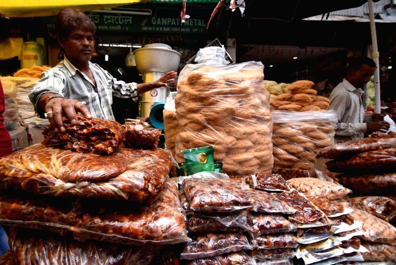 A shopkeeper sells dates ahead of Ramadan in Guwahati, on May 27, 2017.