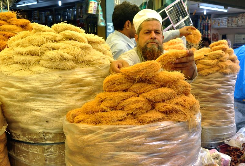 A shopkeeper sells vermicelli during Ramadan in Guwahati on July 8, 2014.
