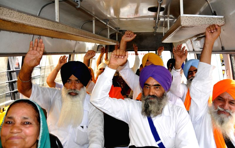 A Sikh `jatha` going to Pakistan to observe the death anniversary of Maharaja Ranjit Singh at Amritsar on June 21, 2014. - Ranjit Singh