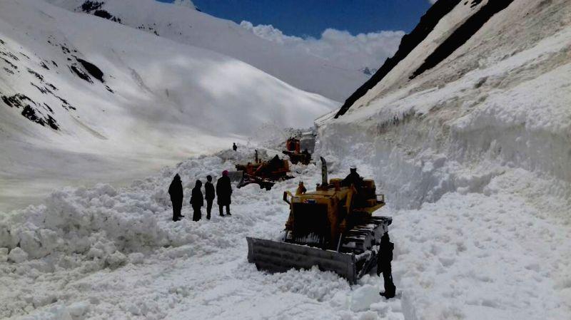 A snow cutter deployed to clear Srinagar-Leh Highway near  Zojila Pass in Sonamarg of Jammu and Kashmir on May 11, 2017.