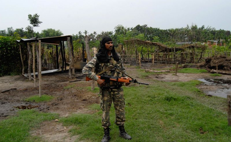 A soldier at Narayanguri Relief Camp setup to provide shelter to those who fled their villages after recent violence in Bodoland Territorial Area Districts (BTAD), in Baksa district of Assam on May ..